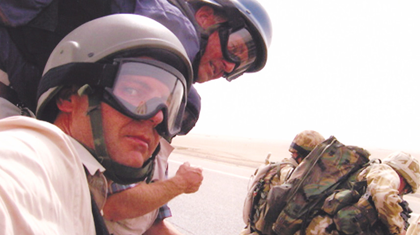 Brent Sadler and CNN cameraman Christian Streib (foreground) prepare to board a US helicopter for a mission in Iraq