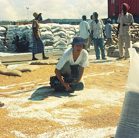 Mogadishu 1992 during Somalia famine – CNN camerawoman Cynde Strand shoots pictures of rice granules scattered in the dirt that had fallen from food aid delivery trucks