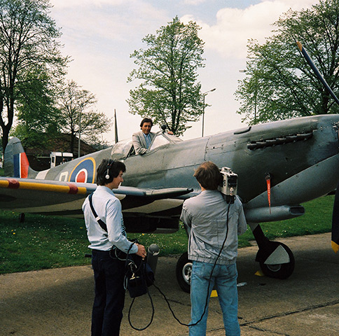 Brent Sadler recording a stand-up for ITN before taking to the skies in a two-seater Spitfire